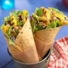 Beach Goers' Wraps - Grill up some sweet ripe pineapple, peach, and mango slices, toss with raspberry vinegar and fresh salad mix for a perfect, summer wrap.