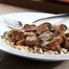 Beef Bourguignonne - Swanson(R) Beef Broth and a little red wine smooth out the savory herb and earthy flavors in this skillet simmered beef and mushroom main dish, served over orzo.