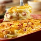 Country Scalloped Potatoes - This tempting potato dish features thinly sliced potatoes layered with sliced onion, diced cooked ham and a creamy sauce featuring Campbell's(R) Condensed Cream of Celery Soup and Campbell's(R) Chicken Gravy, then topped with shredded Cheddar cheese and baked until the potatoes are tender and the cheese melts.