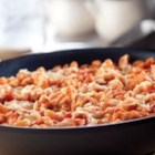Quick Skillet Chicken and Macaroni Parmesan - Simmering the chicken  and pasta in Italian sauce gives this dish a cooked-all-day flavor. Toss the mozzarella right in the skillet for a hot and bubbly dish.