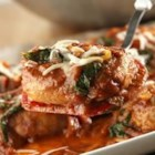 Skillet Pork Chops Florentine - Juicy pork chops are sauteed to perfection and served with an appealing sauce made with marinara Italian sauce, frozen chopped spinach and onion, then topped with shredded mozzarella cheese.