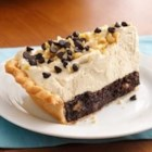 Mile-High Peanut Butter-Brownie Pie - A creamy peanut butter filling tops a brownie layer, all in a flaky pie crust.