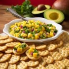 Town House(R) Crackers with Avocado and Mango Salsa - Avocado and mango salsa with the kick of chopped jalapenos is served with crackers for a colorful, zesty appetizer.