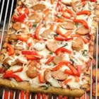 Grilled Sausage and Pepper Pizza - Pizza on the grill is really easy with Pillsbury(R) refrigerated artisan pizza crust with whole grain. Top with turkey sausage, bell pepper and cheese; it's delicious!