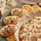 Blue Cheese Spread - Here's a quick and tangy appetizer--crumbled blue cheese, green onions, and chopped tomatoes are mixed into a creamy base and served on buttery crackers.