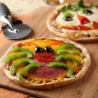 Creepy Mini Pizzas - Set out your favorite pizza toppings and let everybody create their own spooky or fun masterpiece!