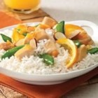Yummy Orange Chicken and Rice - Grilled or roasted chicken simmered in orange marmalade with delicious orange slices and crispy sugar snap peas served over Minute White or Brown rice.