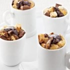 Caramel Dark Chocolate Mini Bread Puddings - After a special dinner serve chocolate and caramel mini bread puddings topped with a creamy chocolate sauce.