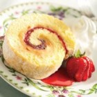 Strawberry and Peanut Butter Cream Cake Roll - The irresistible combination of peanut butter and strawberry jam is swirled into the middle of this cake roll.