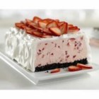 Strawberry Whipped Sensation - Fresh strawberries in a creamy whipped mixture on a chocolate cookie base are topped with more strawberries for an elegant frozen dessert.