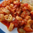Cavatini I - Feed a crowd with this meaty pasta casserole. Chopped ham, chicken and ground beef are mixed into tomato sauce with sauteed onions, green peppers and mushrooms. Layer to bake with pasta and cheeses.