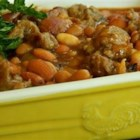 Aunt Ro's Baked Beans - Easy to make using a variety of canned beans, this recipe combines butter beans, pinto beans, pork and beans, and chopped onion with traditional seasonings for rich, savory baked beans.