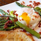 Roasted Asparagus Prosciutto and Egg - Prosciutto and asparagus pair deliciously with poached eggs and a sprinkling of lemon.