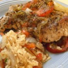 Kent's Pork Chop Casserole - Pork chops are baked with rice, onion, tomato, herbs, and bell pepper in this easy and delicious one-dish dinner.