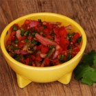 Mi Abuela's Curtida - Crisp and refreshing alternative to salsa. Marinated red onion, tomatoes and cilantro make up this traditional table condiment that is great on chicken tacos or with carne asada. Enjoy and make mi abuela proud!