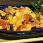 Mexican Corn Casserole  - Corn, tomatoes, and black beans are baked with cream cheese and Cheddar cheese for a creamy, quick, and easy side dish.