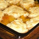 Fresh Peach Cobbler I - Sweet fresh peaches are cooked on the stovetop to make a thick and juicy fruit filling, topped with a homemade biscuit mixture, and baked until golden brown. Serve warm with whipped cream, whipped topping, or ice cream.