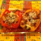 Stuffed Peppers Italian Style - These bell peppers are stuffed with a tasty mixture of bread, onions, garlic, olives and anchovies, and slowly simmered in the oven.