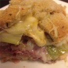 Reuben Casserole - Layers of sauerkraut, corned beef, Swiss cheese, rye bread crumbs, and Russian-style salad dressing make up this casserole version of the deli sandwich .