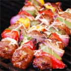 BBQ Sausage and Peppers - Spicy sausage and jalapeno pepper chunks make for some spicy grilled skewers! Melted provolone cheese helps cool things down just a bit.