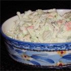 Garden Coleslaw - Using bottled salad dressing is a time saver in  this classic shredded cabbage salad with carrots, peppers and green onions.  Serve with a ham or turkey dinner.