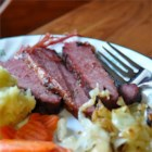 Braised Corned Beef Brisket - Serve a tender corned beef brisket to your family for any special occasion or just because it's so tasty. The meat is slowly cooked in an oven for maximum flavor.