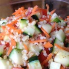 Colorful Bulgur Salad - The bulgur is cooked in chicken broth which gives it a hearty flavor. And the dressing is pungent and wonderful. All the veggies  - tomatoes, carrots and cucumbers  - blend in beautifully, and the whole salad comes alive when chilled.