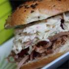 Valerio's Pulled Pork Sandwich - A spice-rubbed pork butt is cooked in a pressure cooker in a sauce of honey, molasses, hot sauce, and garlic. The sweet and spicy pulled pork is then served on a Kaiser roll with homemade coleslaw and barbeque sauce.