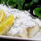 Baked Flounder With Dill And Caper Cream - Baked flounder fillets are dressed up with a creamy caper sauce in this quick and easy fish dinner.