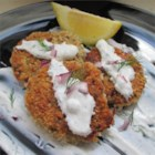 Falafels with Yogurt-Dill Sauce - These falafels topped with yogurt-dill sauce are loaded with herbs and spices for a hearty dish. Wrap in a tortilla for lunch or dinner.
