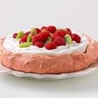 Raspberry Pavlova - A raspberry-flavored meringue shell is topped with fresh raspberries and kiwi slices for an elegant and colorful dessert.