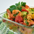 Confetti Shrimp Cocktail Pasta Salad - A colorful, zesty pasta and shrimp salad served ice-cold has the flavor of a Mexican-style shrimp cocktail for a very refreshing lunch or light supper.
