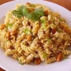 Norris' Sesame Pasta Salad - Pasta is tossed in a sesame dressing with cilantro, peanuts, and green onions for an Asian-inspired pasta salad perfect for any occasion.