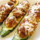 Easy Stuffed Zucchini - Stuff that big zucchini full of ground beef, cheese, sauce, and olives for an easy baked dinner.