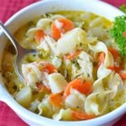 Mom Moak's Chicken Noodle Soup - This chicken noodle soup recipe saves time with the use of pre-cooked or leftover chicken and gets a slight creaminess with the addition of evaporated milk.