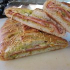 Meat and Veggie Stromboli - Homemade stromboli filled with pepperoni, ham, veggies, and cheese is baked into a flavorful, Italian-inspired meal.