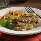Carlton's Scalloped Potatoes - With Carlton's Scalloped Potatoes it's easy to add a gourmet touch to a crowd favorite with pesto, sun-dried tomatoes, artichokes and Romano cheese. It's sure to bring the 'wow' to any potluck.