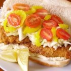 Catfish Po Boy - Crispy fried catfish is piled into hoagie rolls and topped with tangy coleslaw for this authentic Po Boy sandwich.
