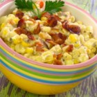 Slow Cooker Creamed Corn with Onion and Chives - Corn is simmered in a creamy bacon sauce in the the slow cooker for a make-ahead side dish perfect for weeknights.