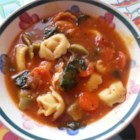 Italian Sausage Soup with Tortellini - Italian sausage, garlic, tomatoes, red wine, and tortellini - this soup combines favorite ingredients from an Italian kitchen.  You can use sweet or hot sausage, depending on your tastes, and fresh herbs if you have them on hand.