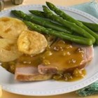 Glazed Ham with Sherry-Orange Dijon Sauce - A hickory-smoked ham is roasted with a brown sugar glaze and served with a spicy sweet and savory sauce made with orange juice, mustard, and sherry.