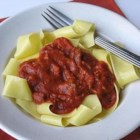 Hearty Pasta Sauce--Ragu Style - What a difference adding meat and red wine makes to everyday pasta sauce! Leftover roast beef and Holland House Red Cooking Wine work wonders to boost flavor. Add both to your favorite jarred pasta sauce or make our hearty pasta sauce -- a Bolognese-style ragu that is traditionally served with wide noodles.