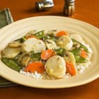 Scallops Primavera - After marinating 30 minutes, scallops are quickly cooked in a lemon and sherry sauce with carrots, mushrooms, pea pods, and green onions for a fast and fresh seafood dinner.