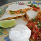 Pico de Gallo Chicken Quesadillas - A fresh tomato-onion relish combines with jack cheese and a saute of chicken, onion and green pepper to fill these grilled tortilla sandwiches.