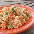 Colorado Mexican Rice - Rice is flavored with a blend of pureed roasted vegetables and sauteed with peas, carrots, and tomatoes. Melted manchego cheese finishes off the dish!