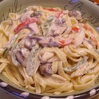 Chicken Primavera Alfredo - Chicken strips, green and red bell peppers, and mushrooms are cooked in butter, then stirred into a creamy, comforting Alfredo sauce with fettuccini.