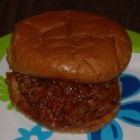 Hodie's Sloppy Joes - Ground beef and onions are simmered with tomato sauce, ketchup, brown sugar, and apple cider vinegar to make this vintage Sloppy Joes recipe.
