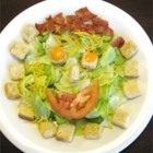 Smiley Salad -  What a fun way to get your child to eat a salad. First comes the lettuce, cheese and bacon bit in individual bowls. And then comes the decoration - croutons for the eyes and nose and a crescent of tomato for the mouth.