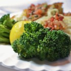 Easy Lemon and Garlic Broccoli - Delicious tender broccoli florets are flavored with lemon juice, butter, and garlic for a tasty side dish that's ready in a snap.
