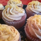 PBJ Cupcakes - Berry Cupcakes with Peanut Butter Frosting - A simple pink cupcake flavored with strawberry extract and raspberry jam is frosted with creamy peanut butter frosting. Peanut butter and jelly cupcakes have all the flavor of your favorite sandwich in the sweet form of a cupcake.